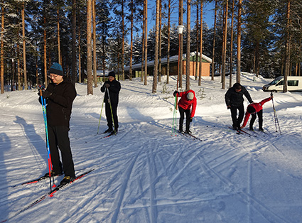 Members of the Chinese delegation on skis.